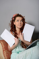 woman with a blank sheet looks up