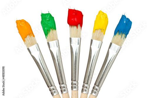 Five paintbrushes with color paints