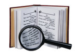 The opened book with a magnifying glass
