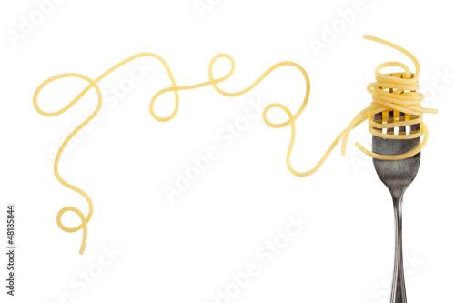 Leinwanddruck Bild Swirls of cooked spaghetti with fork