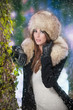 beauty young woman in a winter fashion shot.Winter wild woman