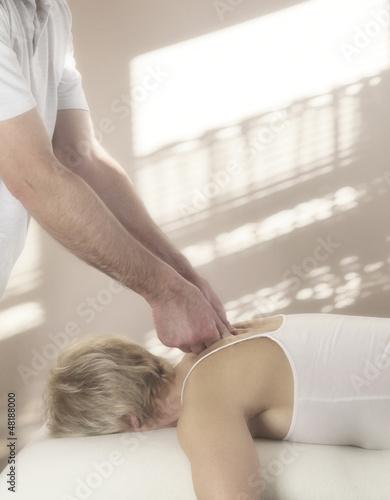 Male therapist treating female, soft focus
