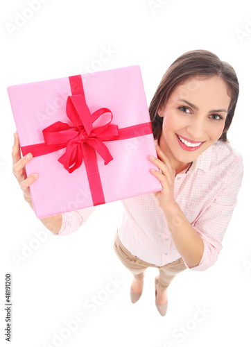 Attractive woman holding gift