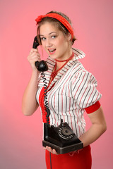 woman with  a vintage phone