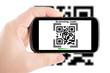 Smartphone in hand scanning code