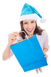 Woman in Santa hat holding shopping bag
