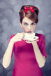Redhead girl with coffee cup. St. Valentine Day.