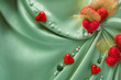 Green satin cloth with red hearts and empty space