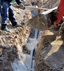 Builder installing water pipes