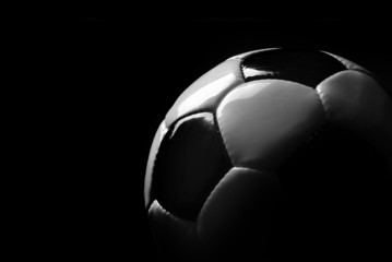 soccer ball isolated in black
