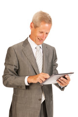Senior business man with tablet