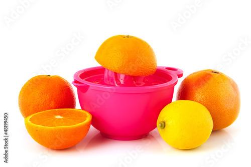 Pressing citrus fruit