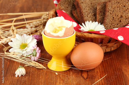 Boiled eggs on wooden background