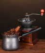 Coffee maker with coffe mill on wooden table