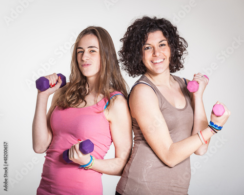 Two Women with Light Weights at Gym