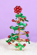 Wire Christmas tree on lilac background