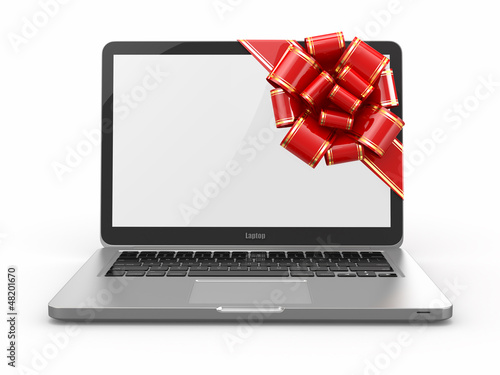 Laptop gift. Bow and ribbon on screen