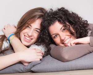 Two Beautiful Women Lying Down with Pillow