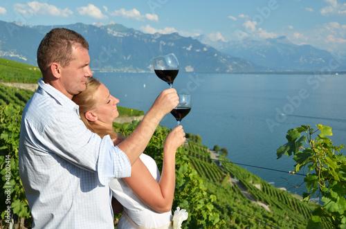 Man and woman tasting wine.Lavaux, Switzerland