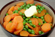 Fresh cooked peas and carrots
