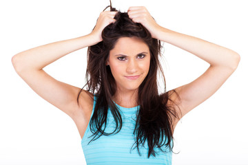 frustrated young woman pulling her hair