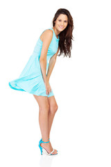 pretty woman in blue dress isolated on white