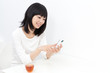 attractive asian woman using smart phone