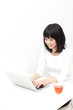 attractive asian woman using laptop
