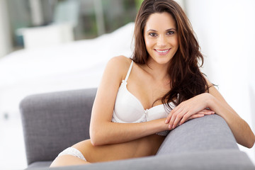 sexy young woman in underwear relaxing on sofa