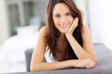 beautiful carefree young woman smiling closeup