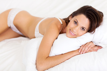 beautiful young woman in underwear lying on bed