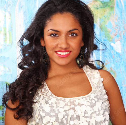 Beautiful smiling indian woman on map background