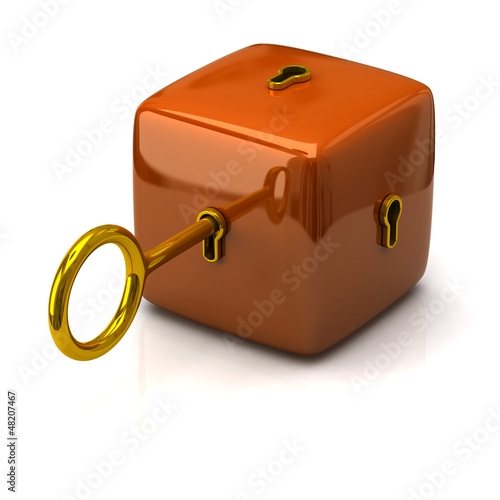 Security concept. Orange cube and golden key.