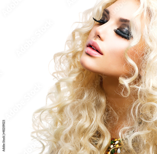 Beautiful Girl with Curly Blond Hair isolated on White
