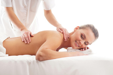 A young woman laying on a spa massage procedure