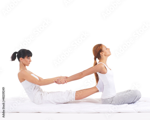 A young redhead woman on a Thai massage procedure