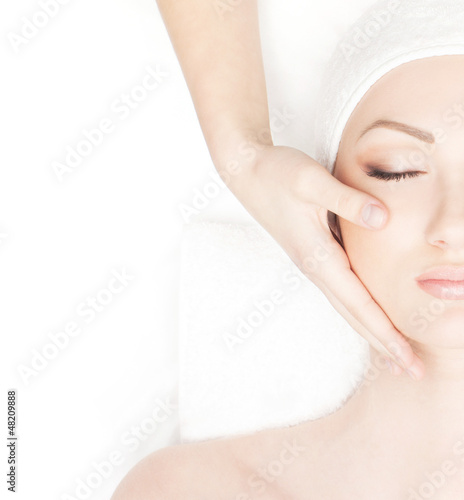 Portrait of a young woman in a towel on a spa procedure