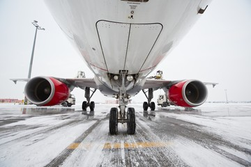 Undercarriage of the airplane in winter