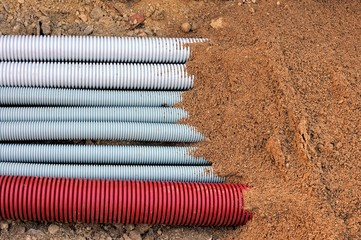 beam corrugated underground conduits covered with sand