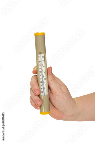 Thermometer to measure the temperature in a female hand isolated