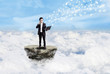 Businessman and social media above clouds