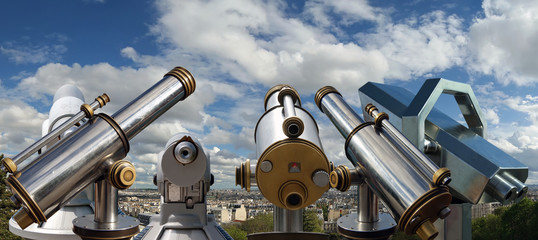 Telescope viewer and Paris skyline