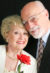 Elegant Senior Couple with Rose