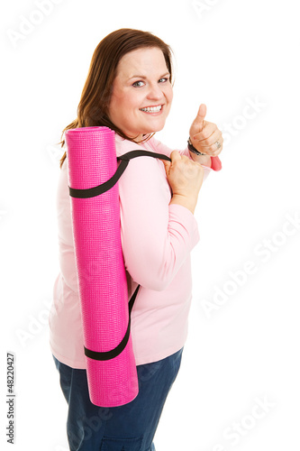 Perky Plus Sized Woman with Yoga Mat