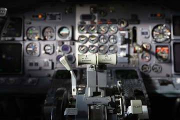 Center console and throttles in the airplane.