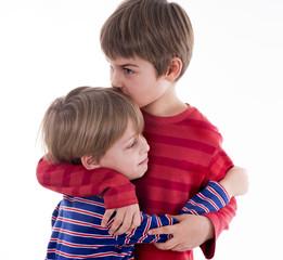 two happy boys hugging