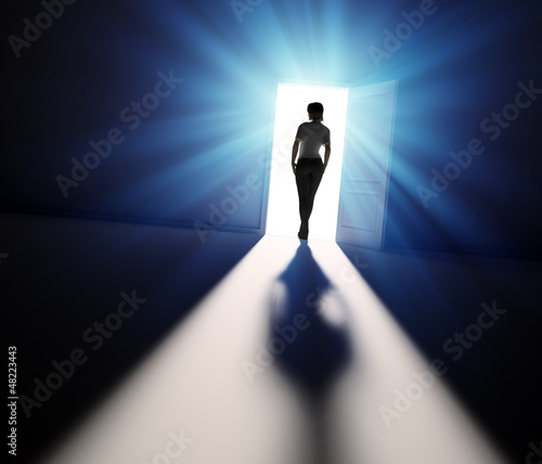 Woman walking into light