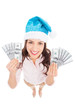 Woman in Santa hat holding money