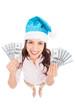 Woman in Santa hat holding money