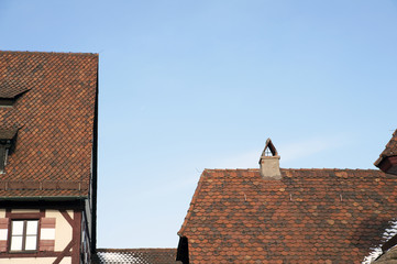 Detail of some housetop with gable tile roofs, medieval style